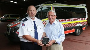 Norman Webster was presented with a NSW Ambulance Cardiac Arrest Survivor Award by paramedic Ron Davidson. Source: News Limited